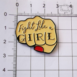 FIST BUTTON WITH THE LABEL FIGHT LIKE A GIRL BUTON